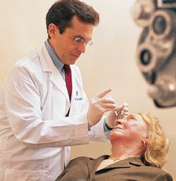 Philip J. Rosenfeld, MD, PhD, shown giving a patient an intravitreal injection